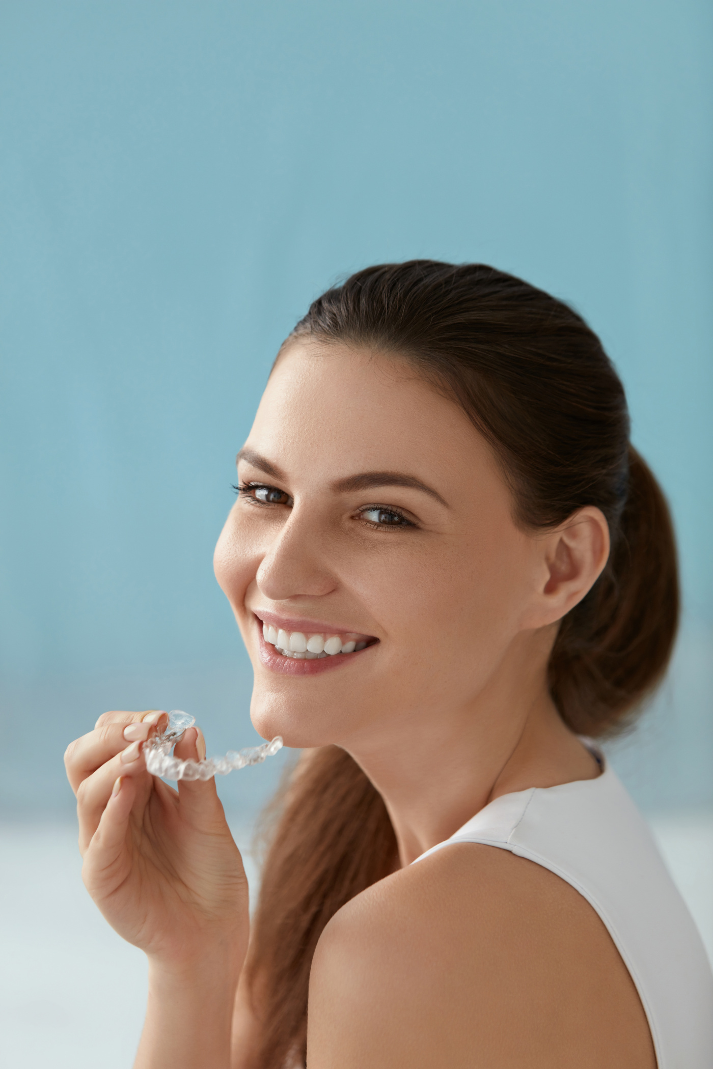 young woman smiling with aligner